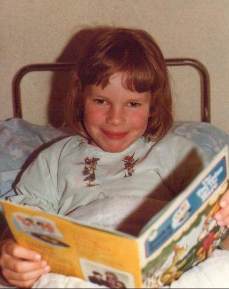 Ali Mercer reading as a child